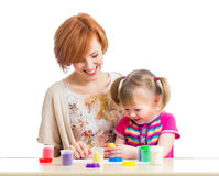 Mother and kid girl play with dough. Mother and daughter play with dough Royalty Free Stock Image