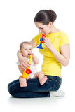 Mother and kid girl play musical toy Royalty Free Stock Image