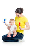 Mother and kid girl play musical toy Royalty Free Stock Photo