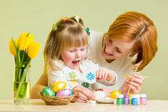 Mother and kid girl play and prepare to easter Stock Images