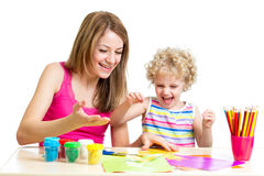 Mother and kid girl play together Stock Photography