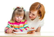 Mother and kid girl read a book Stock Images