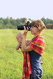 Mother with the kid on hands photographs Royalty Free Stock Photography