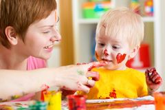 Mother and kid have fun with paints Stock Images
