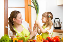 Mother and kid  have fun preparing healthy food Royalty Free Stock Photography