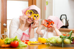 Mother and kid have fun preparing healthy food Royalty Free Stock Image