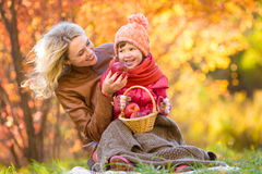 Mother and kid have pinic together in autumn park Stock Photography