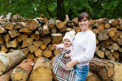Mother and the kid have a rest in autumn wood. Stock Images