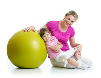 Mother and kid having fun with gymnastic ball Stock Photos