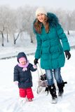 Mother and  kid having fun outdoors on  winter day Royalty Free Stock Photo