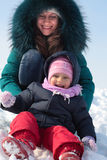Mother and  kid having fun outdoors on  winter day Stock Photos