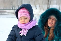 Mother and  kid having fun outdoors on  winter day Stock Photography
