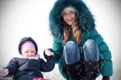 Mother and  kid having fun outdoors on  winter day Royalty Free Stock Image