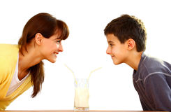 Mother and kid with milk Royalty Free Stock Photos