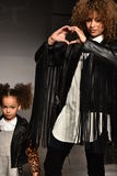 Mother and kid model walks runway at Laer Fall/Winter 2016 Runway Show during petiteParade Stock Image