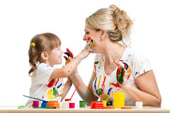 Mother and kid paint together Royalty Free Stock Images