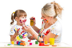 Mother and kid paint Royalty Free Stock Photos