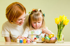 Mother and kid painting Easter eggs. Mother and daughter kid painting easter eggs Stock Photos
