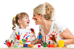 Mother with kid painting and have fun pastime Stock Photography