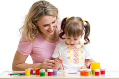 Mother and kid painting together Stock Photo