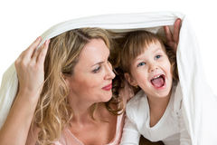 Mother and kid peeking out from under blanket stock image