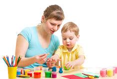 Mother and kid plasticine modeling together isolated Royalty Free Stock Photo