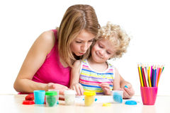 Mother and kid play together stock photo