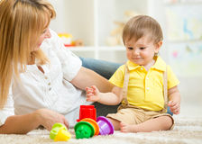 Mother and kid playing block toys at home Stock Image