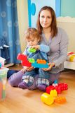Mother and kid - playing with blocks Royalty Free Stock Photos