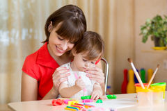 Mother and kid playing at home Stock Images