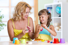 Mother and kid playing plasticine at home Royalty Free Stock Images