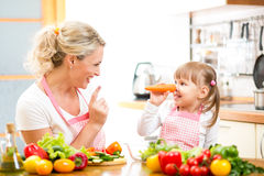 Mother and kid preparing healthy food Stock Photos
