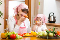 Mother and kid preparing healthy food and having fun. Mother and child preparing healthy food and having fun Royalty Free Stock Photography