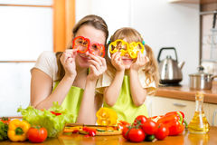Mother and kid preparing healthy food and having fun Royalty Free Stock Image