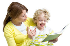 Mother and kid reading a book together Stock Photo