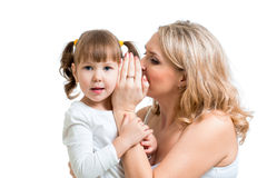 Mother and kid sharing a secret whispering Royalty Free Stock Photo