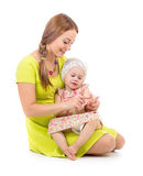 Mother and kid sitting and counting fingers together Royalty Free Stock Photo