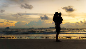 Mother and kid at sunset beach Royalty Free Stock Image