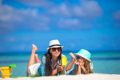 Mother and kid with suntan lotion on tropical Royalty Free Stock Image