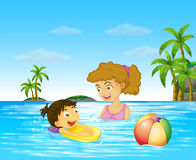 Mother and kid swimming in the ocean Stock Photo