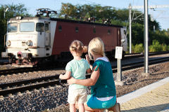 Mother and kid waiting for train on railway station platform Stock Photography