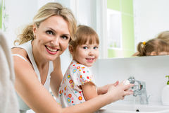 Mother and kid washing hands Stock Photo
