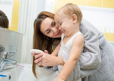 Mother and kid washing hands with soap together Royalty Free Stock Photography