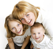 Mother with Kids. Happy Smiling Family over white Stock Images