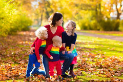 Mother and kids in autumn park Stock Photos