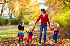 Mother and kids in autumn park Stock Photo