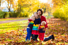 Mother and kids in autumn park Royalty Free Stock Photo