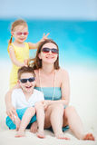 Mother and kids at beach Stock Photography
