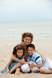 Mother and kids on the beach Stock Photography