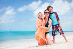 Mother and kids at beach Stock Photos